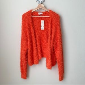 NWT Urban Outfitters Orange open front cardigan